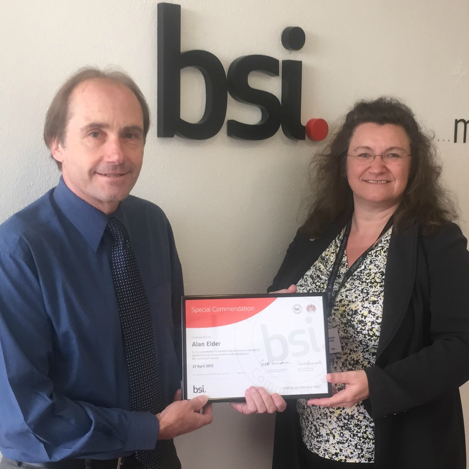 Alan Elder (left) receives his award from Debbie Stead, BSI