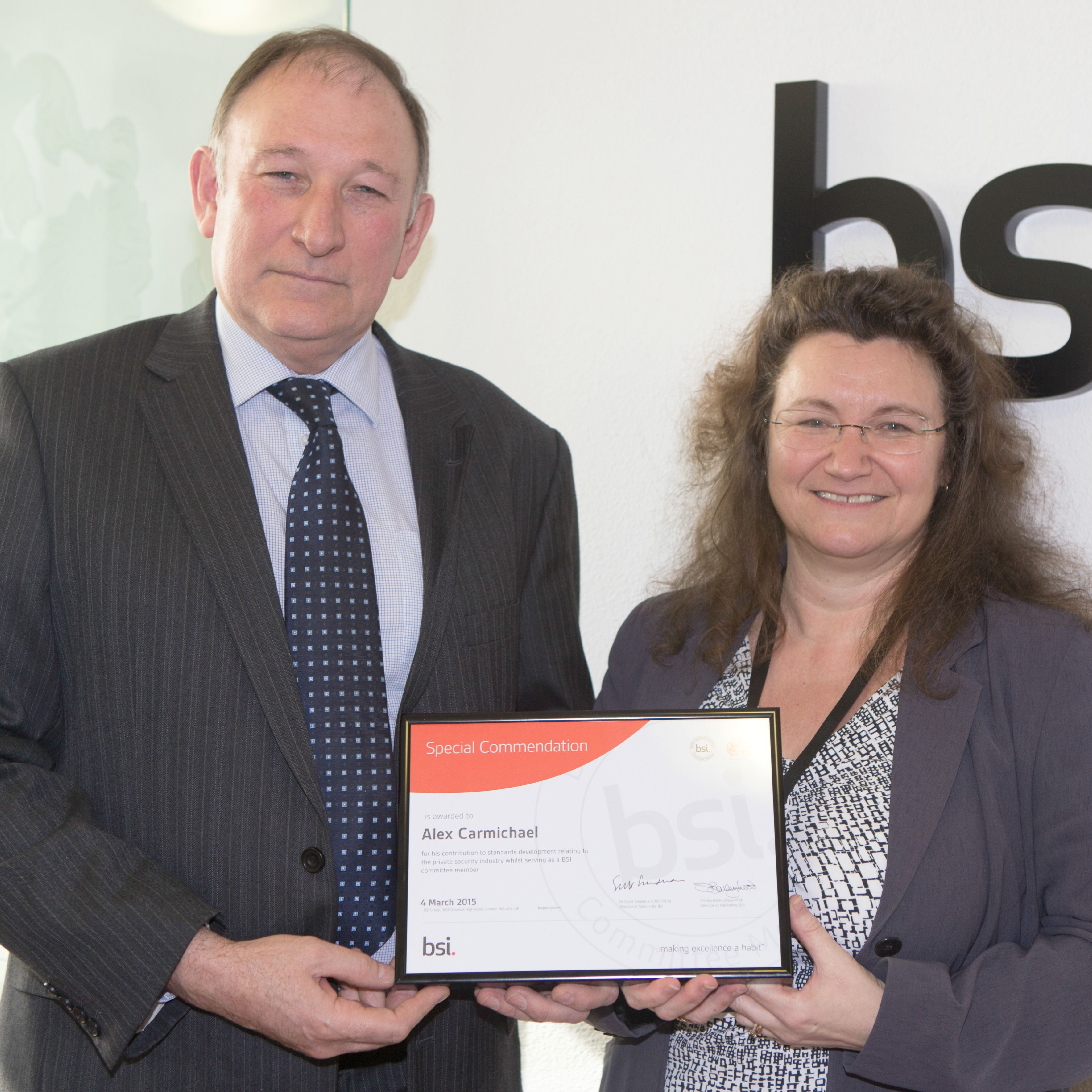 Alex Carmichael (left) receives his award from Debbie Stead, BSI