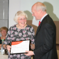 Anne Smith (left) receives her award from Dr Scott Steedman CBE