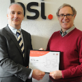 Bob Whiteley (right) receives his award from Jim Shuker, BSI