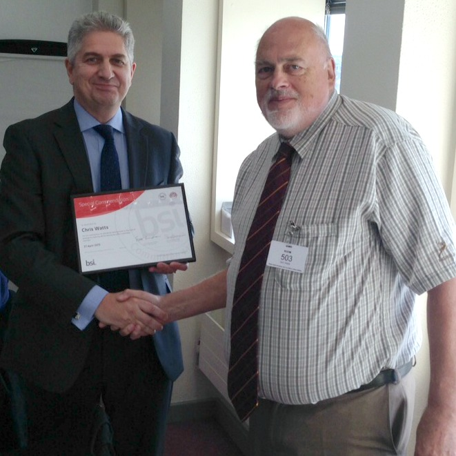 Chris Watts (right) receives his award from Richard Taylor, BSI
