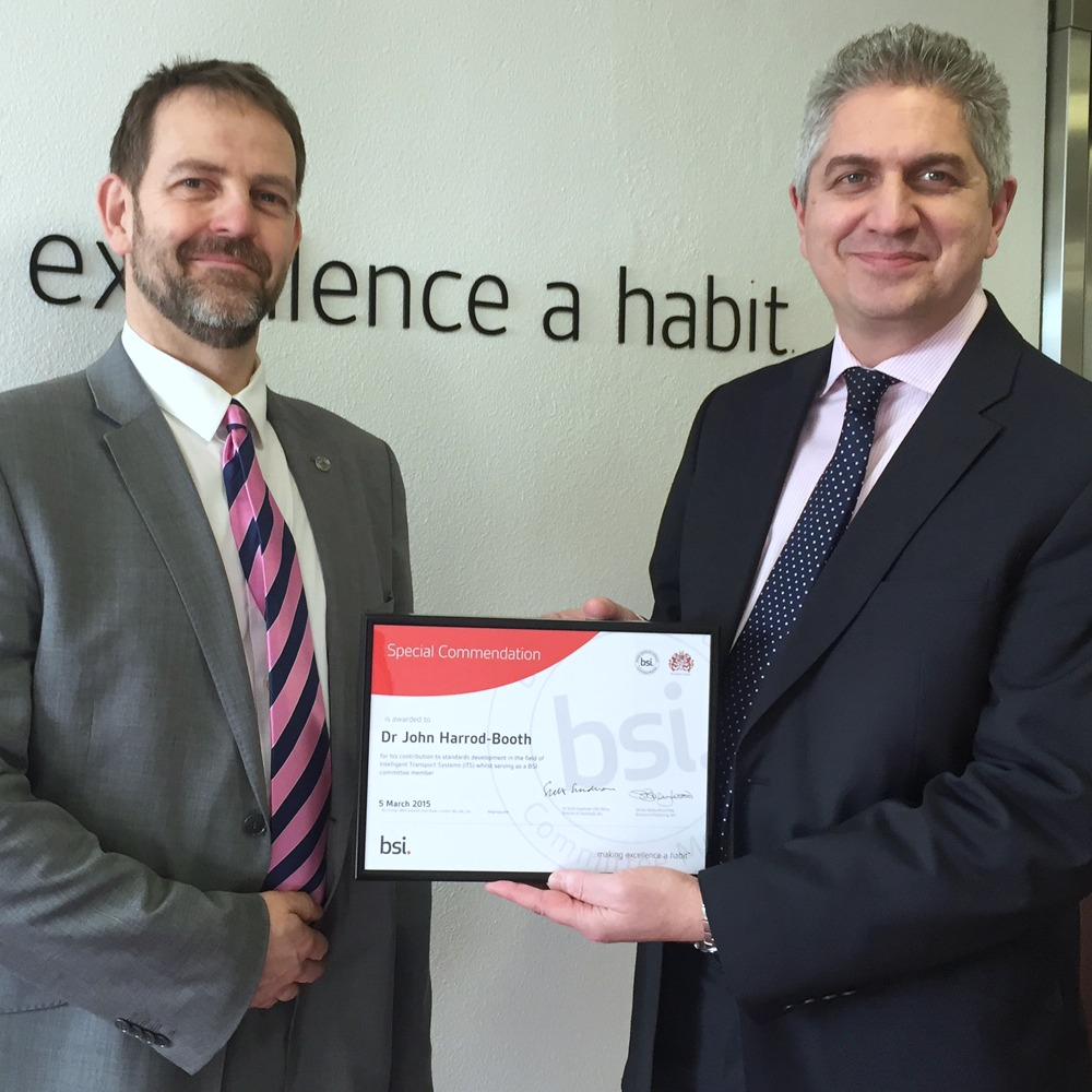 Dr Jon Harrod-Booth (left) receives his award from Richard Taylor, BSI