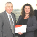 Malcolm Loveday (left) receives his award from Debbie Stead, BSI