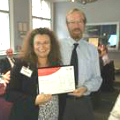 Mark Coates (right) receives his award from Debbie Stead