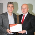 Neil Avery (left) receives his award from Dr Scott Steedman CBE