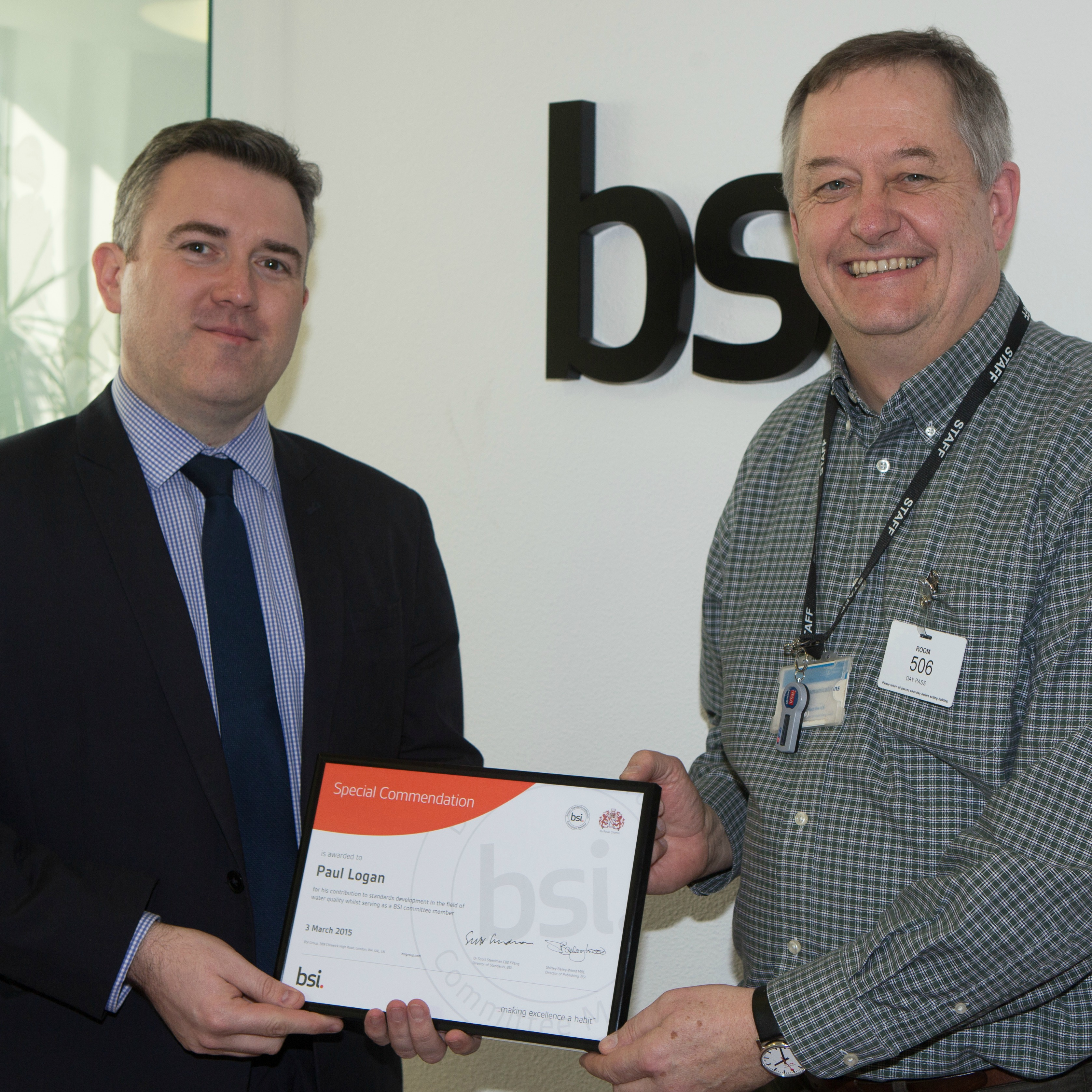 Paul Logan (right) receives his award from David Bell, BSI