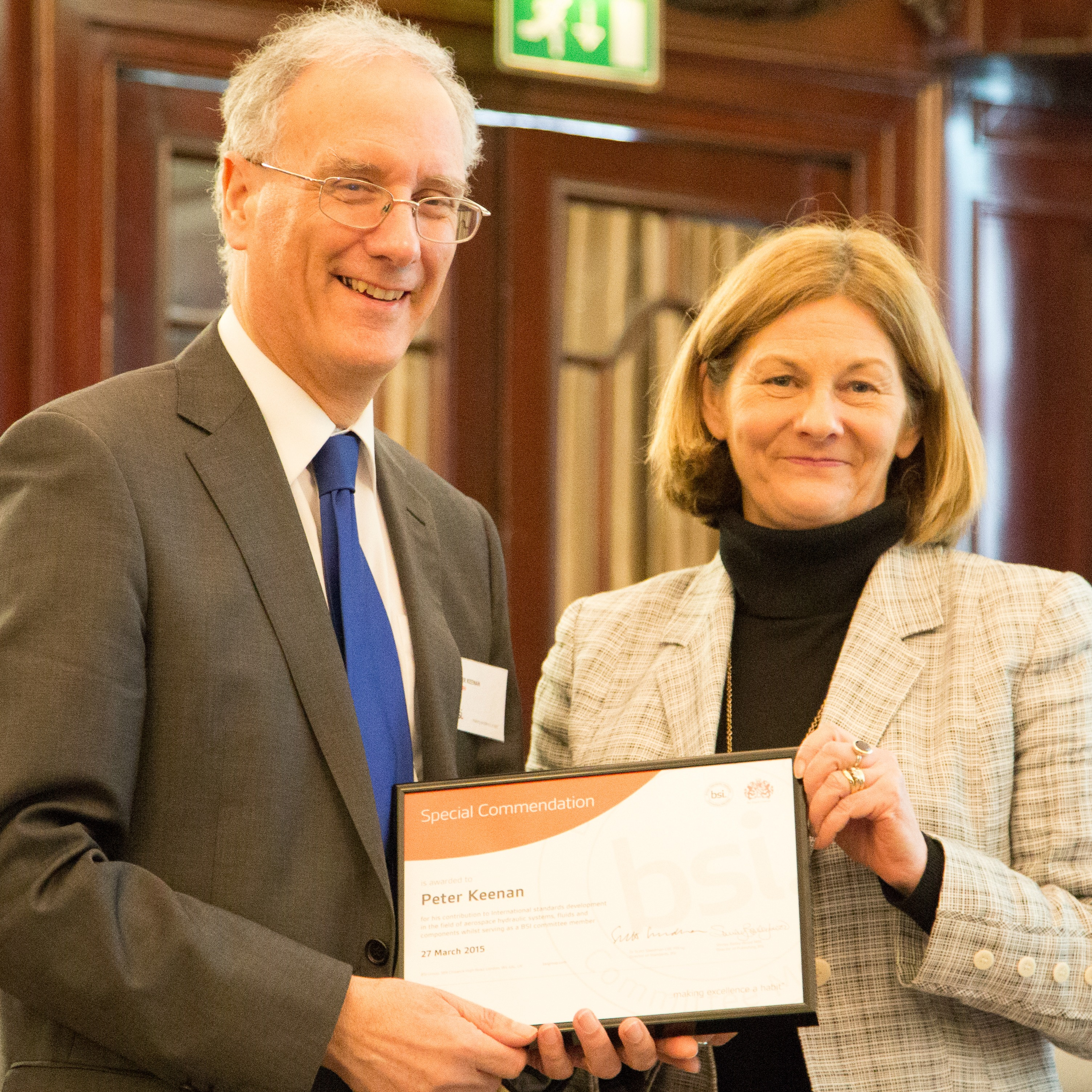 Peter Keenan (left) receives his award from Shirley Bailey-Woods, BSI