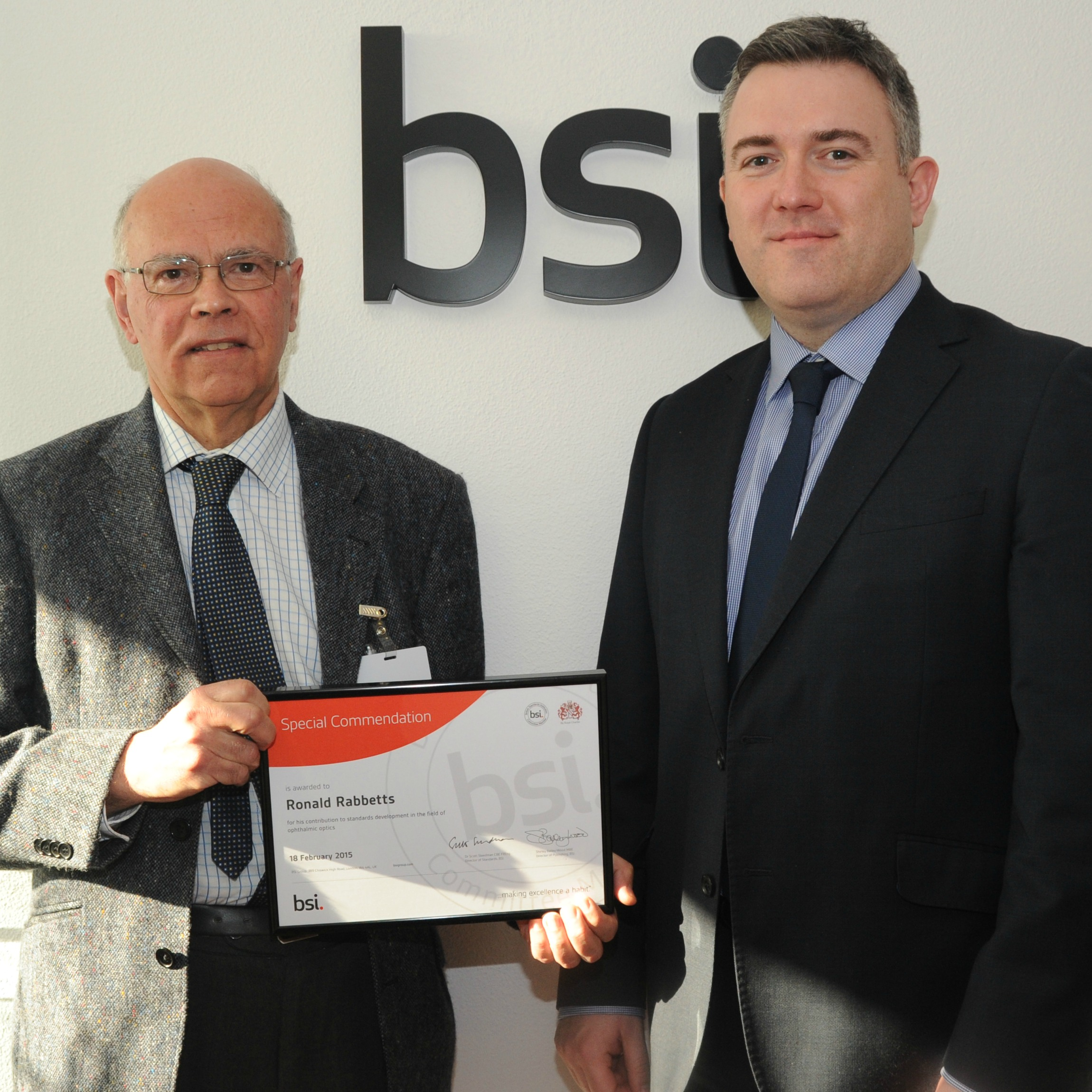 Ronald Rabbetts (left) receives his award from David Bell, BSI