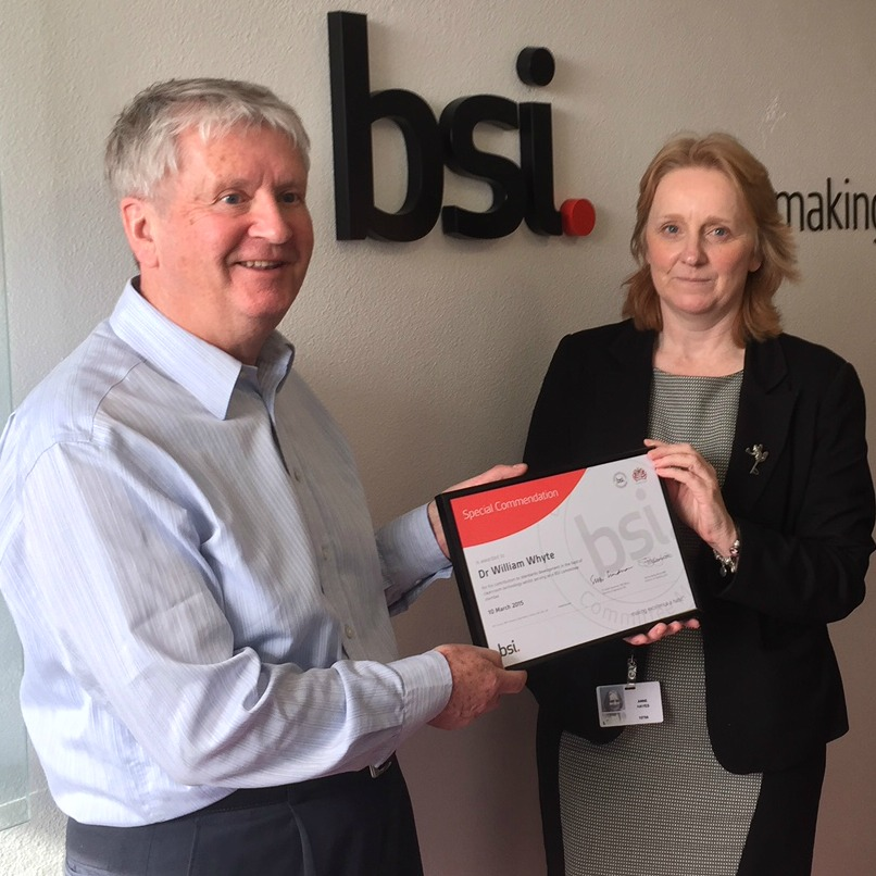 Dr William Whyte (left) receives his award from Anne Hayes, BSI