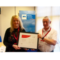 Louise Delaney (left) receives her award from Tim Newins, BSI