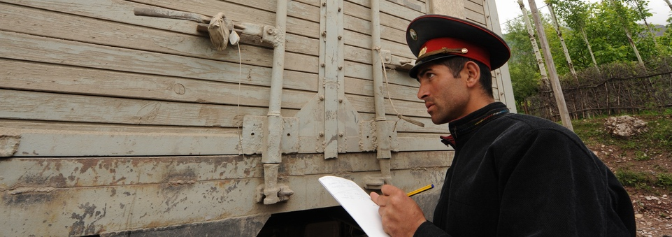 Customs official inspects truck in Tajikistan