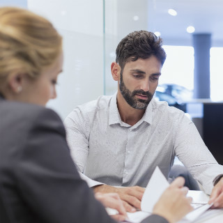 client meeting discussion documents man woman