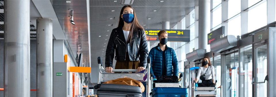 People in airport with protective masks